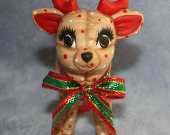 Handpainted Ceramic Christmas Reindeer Baby Standing painted with a holly berry print to look stuffed