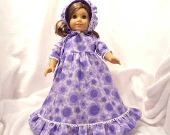 Shades of purple floral print, long dress for 18 inch dolls, with white lace trim.