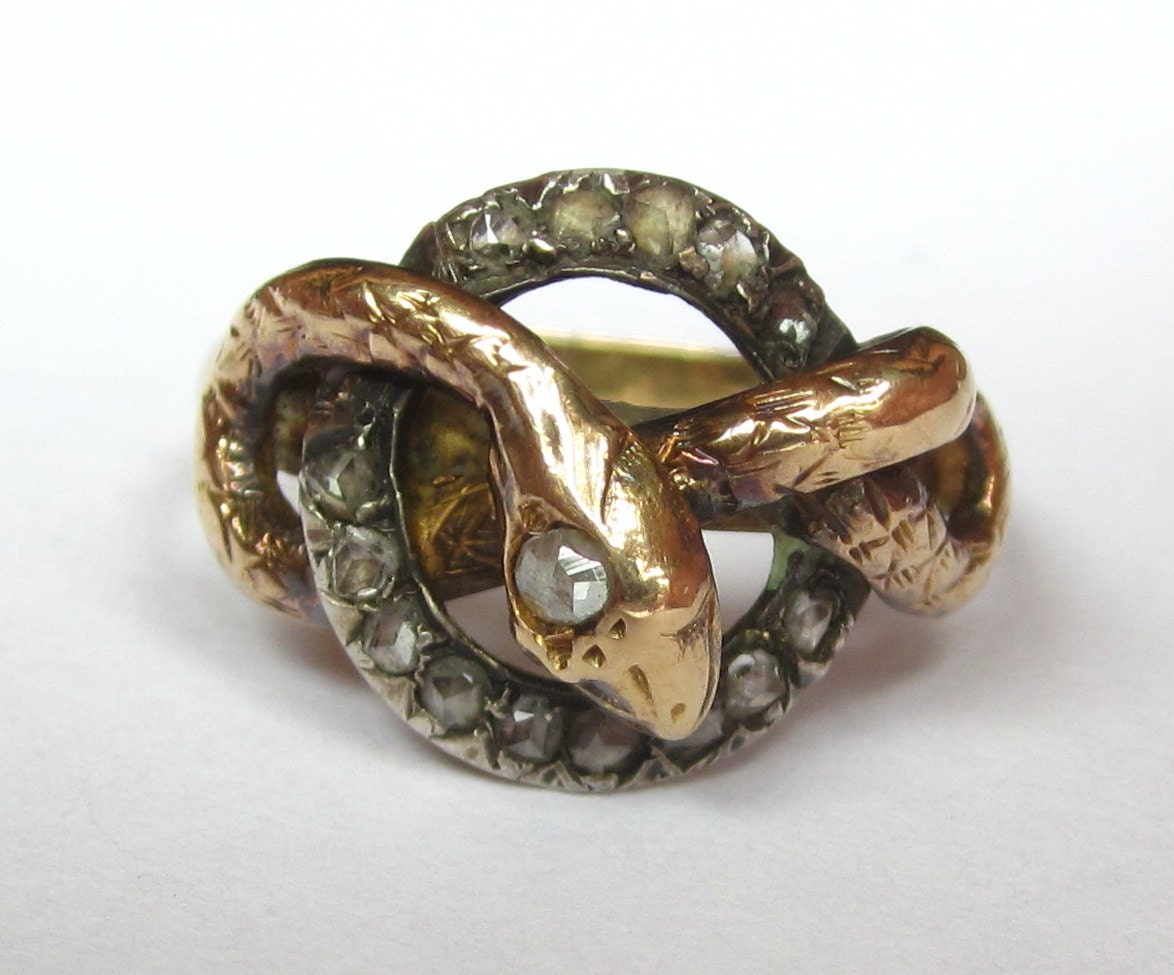 Stunning Early Victorian Snake Entwined In A Diamond Circle. Dreamcatcher Rings. Brushed Copper Rings. Quirky Wedding Wedding Rings. Turquoise Gemstone Engagement Rings. Black Gold Engagement Rings. Daisy Cluster Engagement Rings. Colored Gemstone Wedding Rings. Roundengagement Engagement Rings