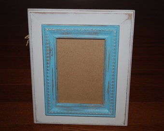 Off white with blue trim distressed 5 x 7