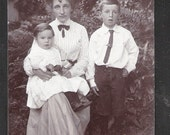 100 year old Social History Postcard mother  with son and maybe daughter antique vintage postcards
