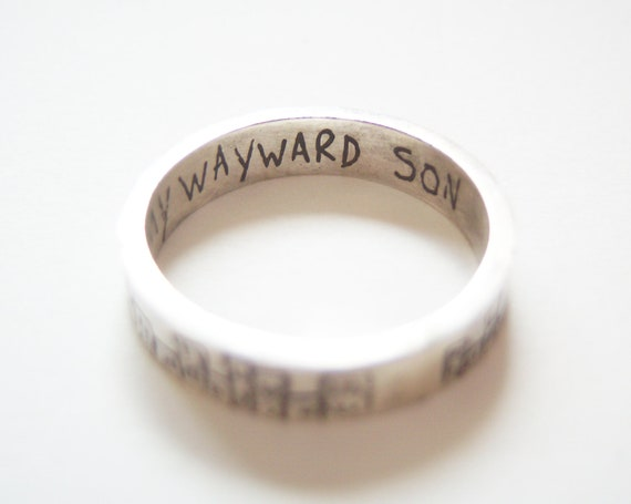 Supernatural cityscape etched silver ring with 'Carry On My Wayward Son' inscription