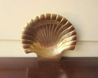 Heavy nautical brass shell for classic home decor.