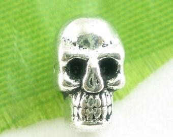 40 Tiny Silver Metal SUGAR SKULLS Bead Charms  9mm long  bme0107
