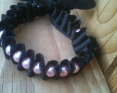 Black ribbon and pink pearl bracelet