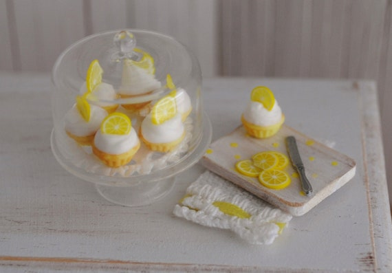 Miniature Lemon Cupcakes On A Glass Covered Stand