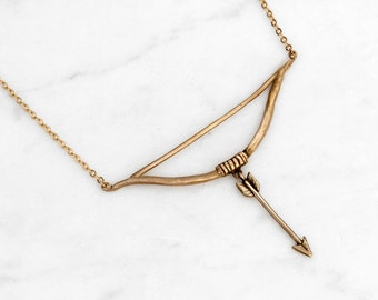 Golden bow and arrow necklace