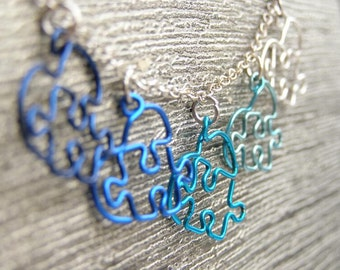 Puzzle Hearts Necklace - Lots O' Love - Blue and Silver