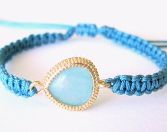 Adjustable Macrame Bracelet with a Blue Green Connector Gold Beads and Blue Thread