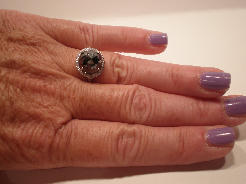 ... 5-Carat Rose-Cut Black Diamond Ring with White Diamond Accents. 🔎zoom