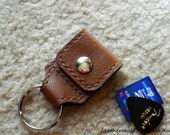 100% hand stitched med brown cowhide leather keychain / SD card / guitar pick / golf ball marker holder with a free Fender Celluloid pick