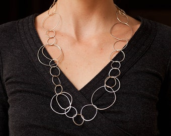 Gold and Silver Circle Necklace. Organic shaped hand hammered links with natural texture. Handmade chain. Statement Necklace.