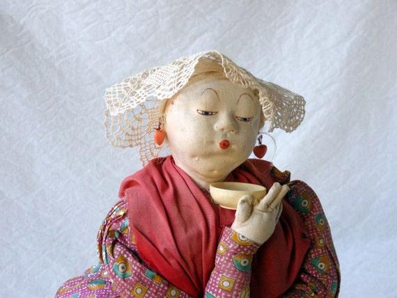 Tea cosy cloth doll, Queen Victoria impersonator of Russian origin, with doily