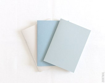 Pastel set of beige, blue and gray handmade notebooks (journals)