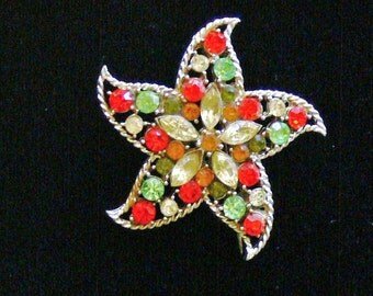 orange and green 5 point star glass  brooch