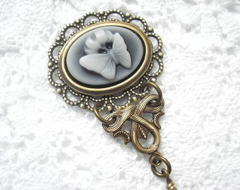 Gray and White Butterfly Cameo Pendant in Antiqued Brass