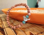 Bird Charm with Blue Czech Glass Beads and Wooden Bead Bracelet