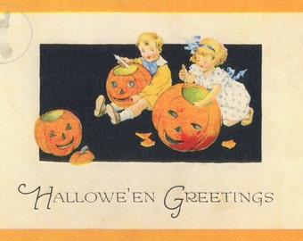 Vintage Halloween Decorating: This cute art print was sourced from an antique postcard showing children carving pumpkins