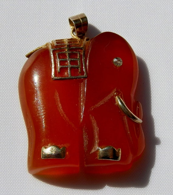 Carnelian Elephant Pendant. Hand carved. With gold accents.