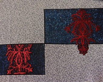 Japanese kimono silk featuring metallic blue and red featured pattern.