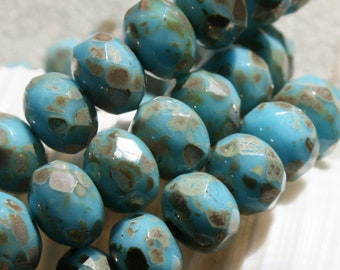 6 x 8mm . Czech Pressed Glass Rondells . silvery brassy mica like picasso on blue lagoon blue  . 10 beads
