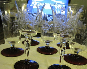 Four Vintage Ruby footed glasses, wine and tea