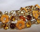 Signed BSK Amber, Root Beer Rhinestone and Thermoplastic Flower Bracelet