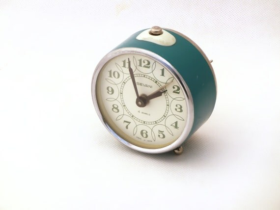 Vintage turquoise alarm clock made in Russia