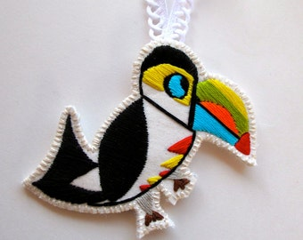 Christmas Toucan ornament hand embroidered geometric shapes with bright colors