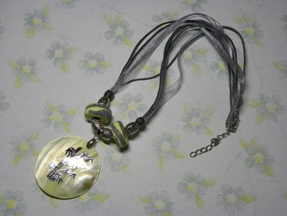 Necklace: Light Yellow Shell Pendant Necklace with Silver Bamboo Decoration