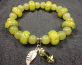 Olive Jade Serpentine Beadwork Charm Bracelet With Yellow & Green Swarovski Crystals And Feather Charm
