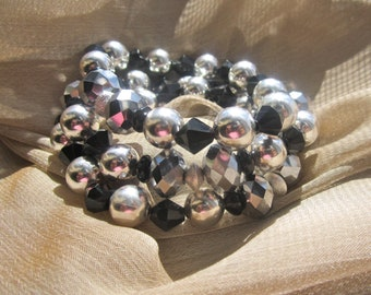 Stackable black and sparkly silver beaded bracelets