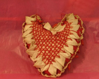 Vintage 1940s heart pillow with white ruffles