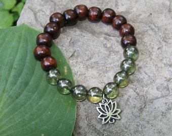 Yoga dark wood bead mala bracelet with lotus leaf charm and green glass beads