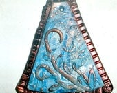 Abstract pendant blue and copper polymer clay