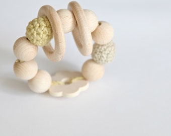 Beige flower teething toy with crochet wooden beads and 2 wooden rings. beige and light sand wooden beads rattle.
