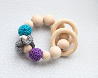 Teething toy with crochet wooden beads and 2 wooden rings. Teal, grey, violet wooden beads rattle.