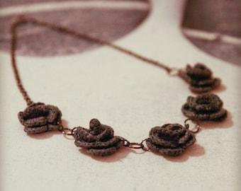 Grey Vuokko floral necklace with gun metal jump rings