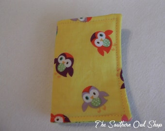 Yellow tossed multi-colored owl print needle book