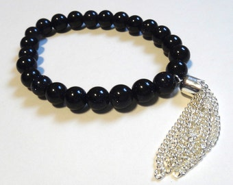Blue Goldstone Beaded Bracelet with Silver Tassel