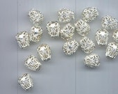 Eighteen vintage shiny white silver tone filigree beads - pear-shaped, 13.5 x 11 mm