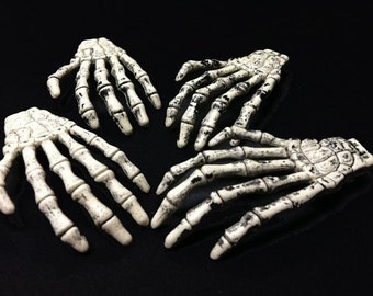 50 Plastic Skeleton Hands Plus 5 free