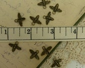 10 antique brass bee charms style size 15 mm wide by 12 mm long hole is 2 mm