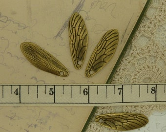 4 antique brass / bronze bee wing charms  size 40 mm long by 14 mm wide hole is 3 mm