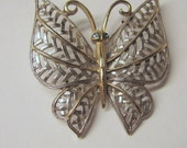 Avon Butterfly in Gold and Silver Tone with Blue Rhinestone Eyes
