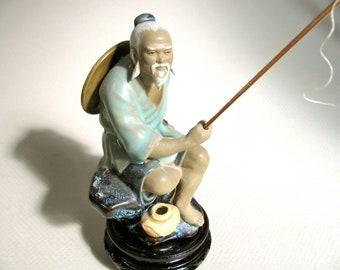 Ceramic mud figure of fisherman