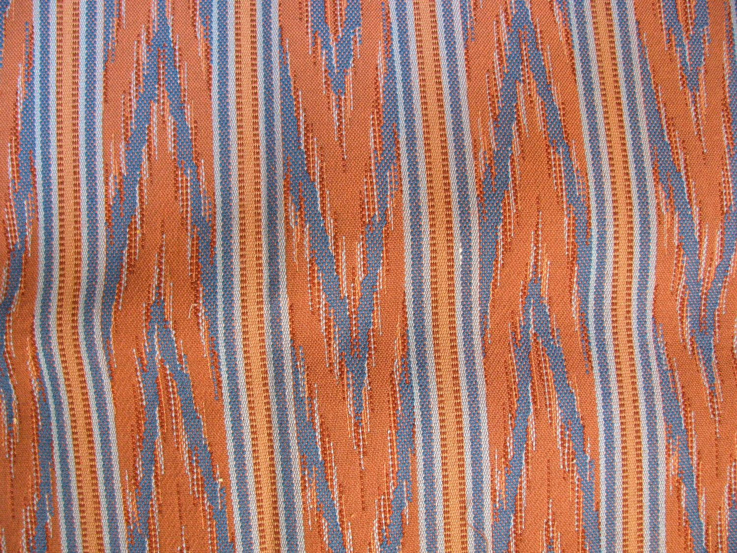destash upholstery fabric in orange and blue. Black Bedroom Furniture Sets. Home Design Ideas