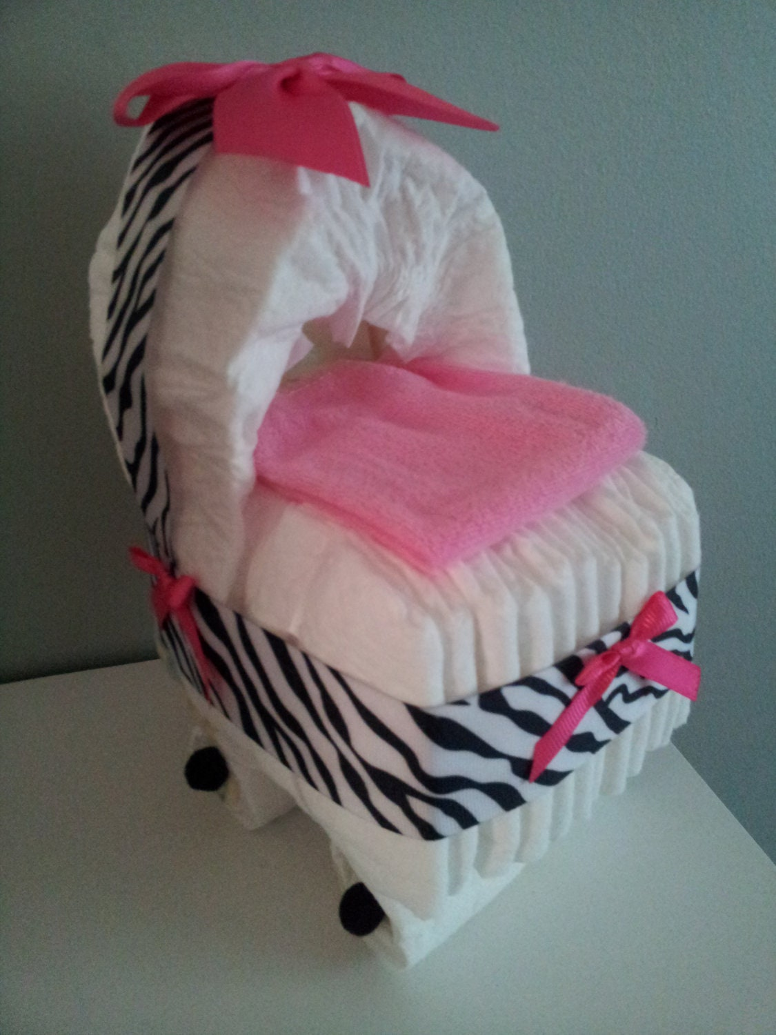 Zebra with hot pink diaper bassinet baby shower decoration for Baby diaper decoration ideas