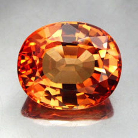 19.67 ct. Lab Created  Simulated Sapphire Padparadscha Red Orange Oval cut