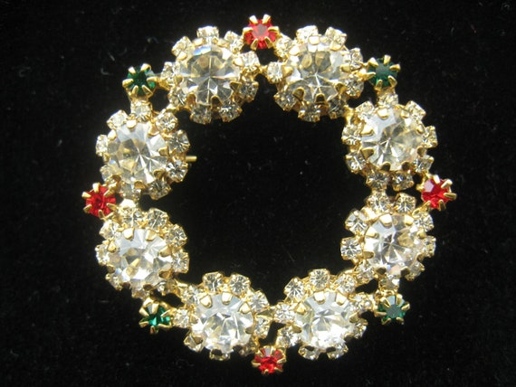 CLEARANCE Vtg Rhinestone Wreath Brooch is prong set with lots of clear Rhinestones plus a few Red and Green ones